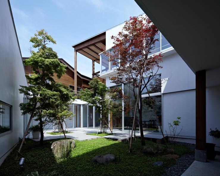 中庭: 工藤宏仁建築設計事務所が手掛けた庭です。