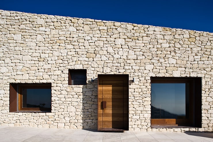 Fachada principal: Casas de estilo  de Tomás Amat Estudio de Arquitectura