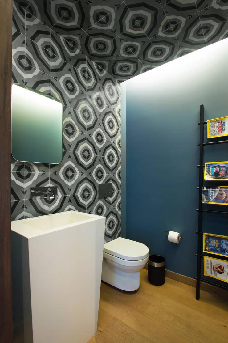Departamento DG: Baños de estilo  por Concepto Taller de Arquitectura