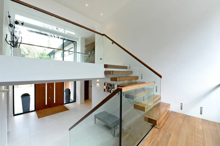 Projekty,  Korytarz, przedpokój zaprojektowane przez Jigsaw Interior Architecture