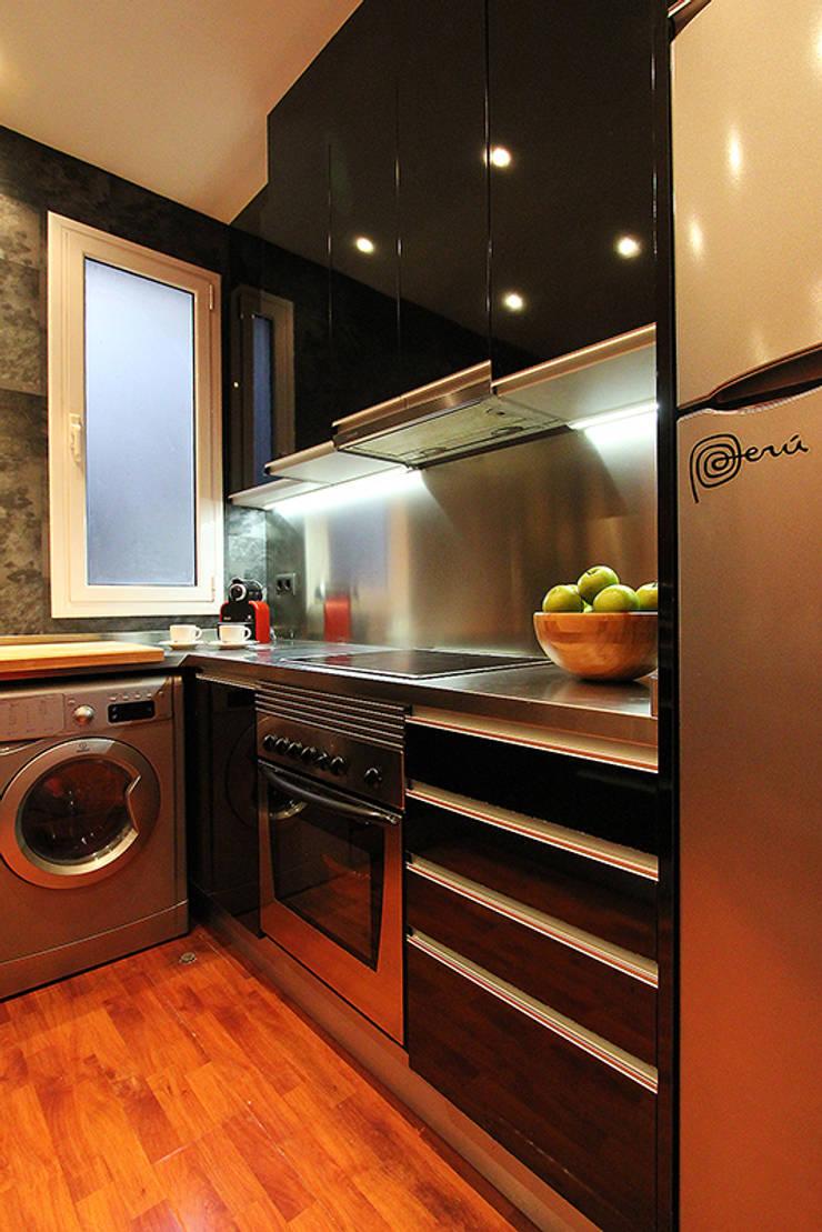 Zona de cocción: Cocina de estilo  de XTe Interiorismo