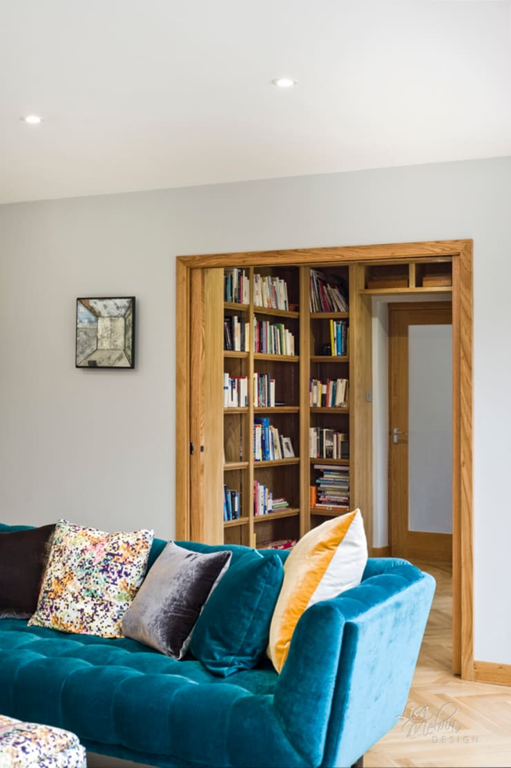 Library with pocket doors :  Media room by Lisa Melvin Design