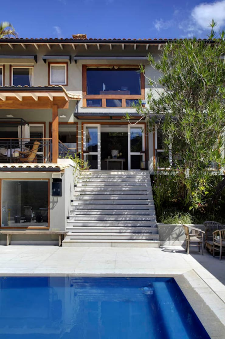 casa CR: Casas campestres por Raquel Junqueira Arquitetura