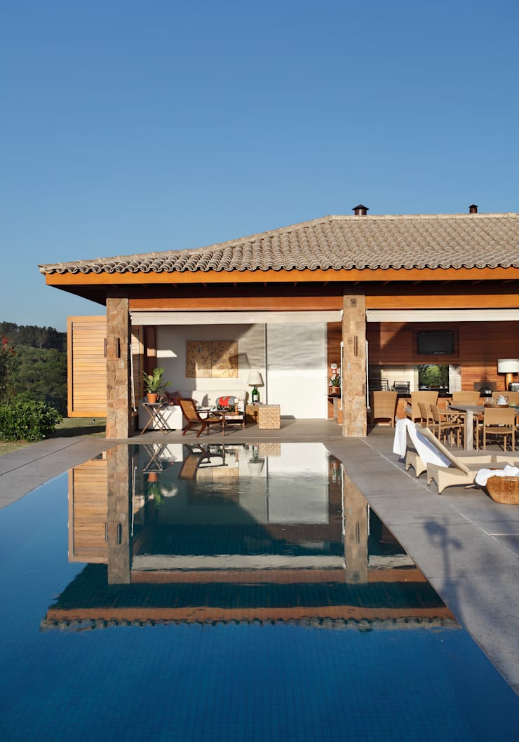 Casa de Pedra: Casas  por Erick Figueira de Mello Arquitetura e Interiores