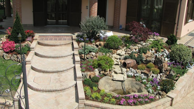 Jardín de estilo  por Azienda agricola Vivai Romeo