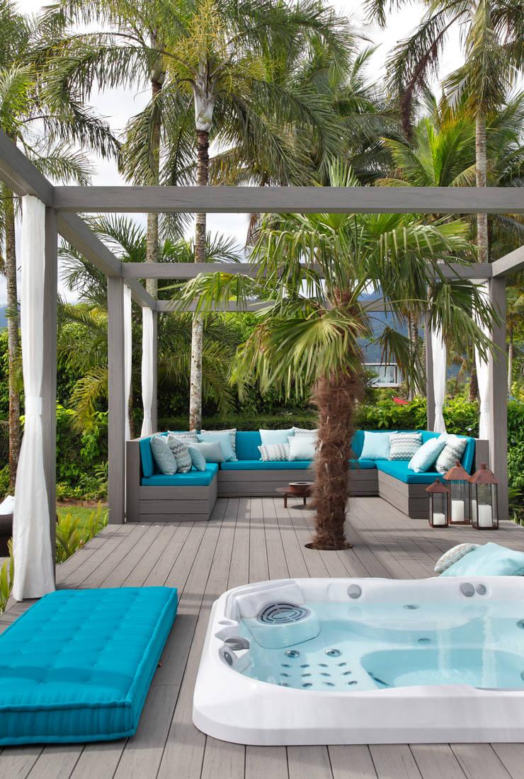 Casa em Angra: Jardins modernos por Lovisaro Arquitetura e Design