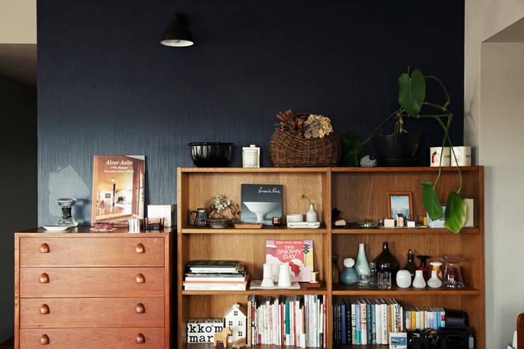 トリミングルーム: 稲山貴則 建築設計事務所が手掛けた壁です。