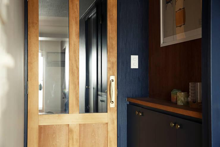 トリミングルーム: 稲山貴則 建築設計事務所が手掛けた窓です。