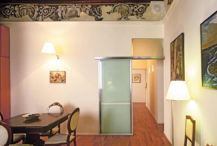 Appartamento in Via Sallustio Bandini: Sala da pranzo in stile in stile Minimalista di Maurizio Piochi