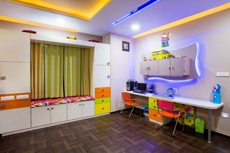 Quarto infantil  por Srujan Interiors & Architects Pvt Ltd