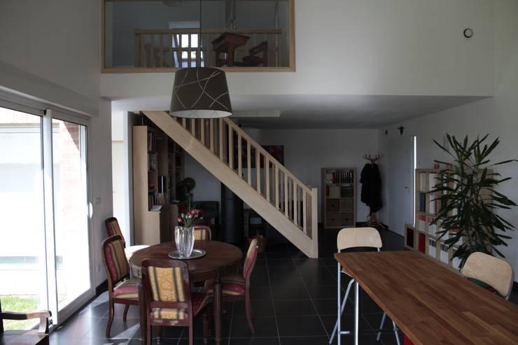 salle à manger:  de style  par Amélie Tremblay-Choteau Architecte d'intérieur