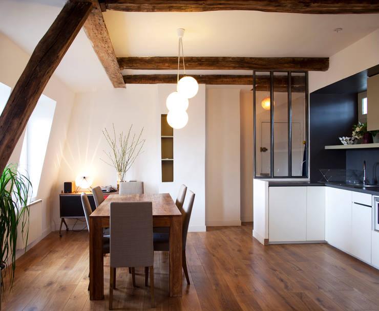 PARIS 11°: Salle à manger de style  par RBB architectes