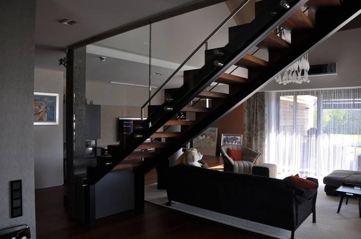 Living room by Studio S Biuro architektoniczne Michał Szymanowski