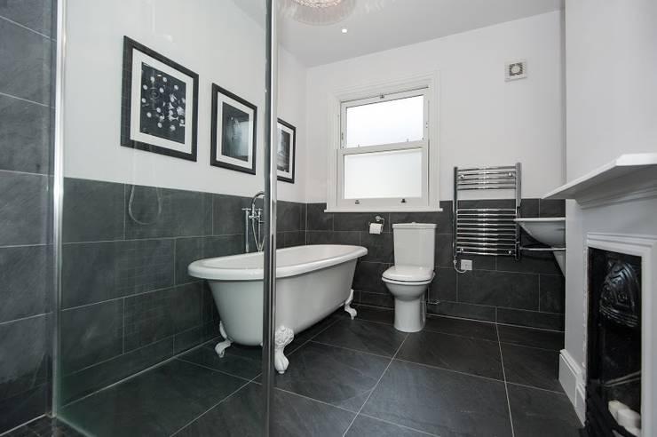 Refurbishment of late Victorian Property: classic Bathroom by Corebuild