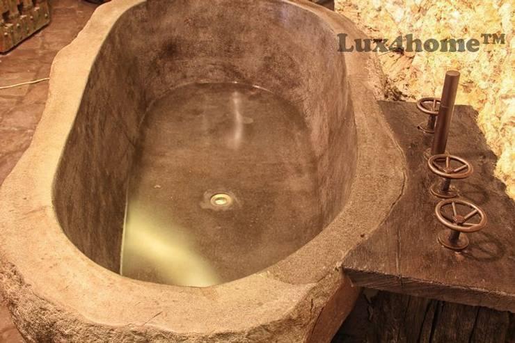 Wanna z kamienia w łazience: styl , w kategorii Łazienka zaprojektowany przez Lux4home™
