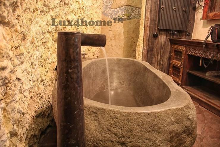 Kamienna wanna w łazience: styl , w kategorii Łazienka zaprojektowany przez Lux4home™