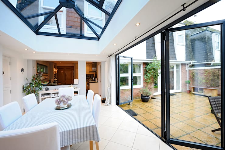 Orangery from kitchen with bi folding doors:  Conservatory by ROCOCO