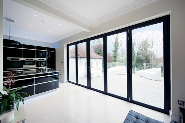 Kitchen Development with Bi Folding Doors:  Windows  by ROCOCO