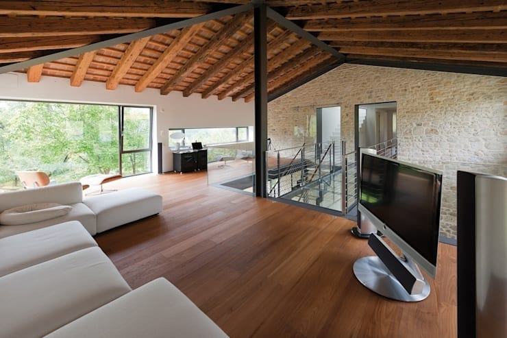 Casa G+S+R+C:  in stile  di Caprioglio Associati Architects