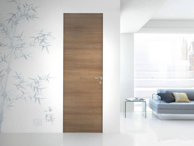 Modello demetra - finitura laminato millerighe brown : Finestre & Porte in stile  di PIETRELLI PORTE