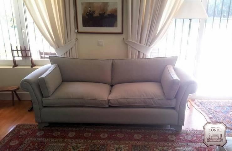 Tapizado de sofá y confección de cortinas: Salones de estilo  de Tapicería Conde
