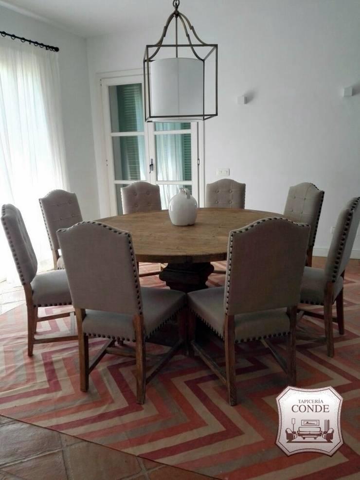 Tapizado de sillas: Comedores de estilo  de Tapicería Conde