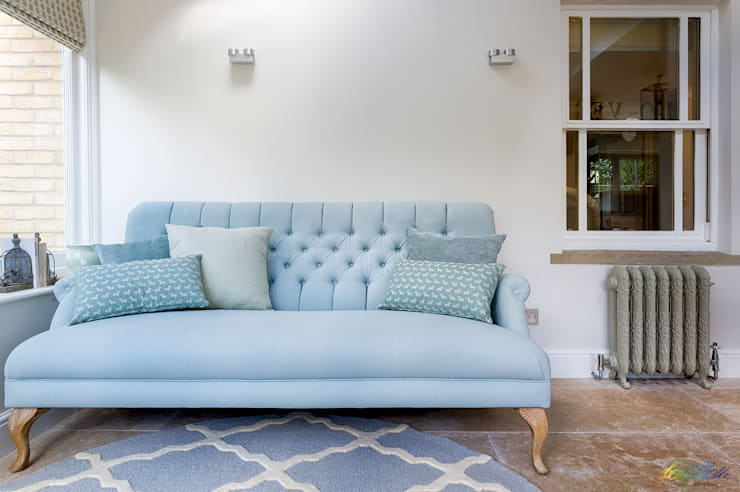 Sofa after: modern Living room by Katie Malik Interiors