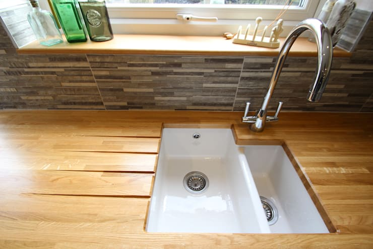 Sink with drain grooves on the worktop:  Kitchen by AD3 Design Limited