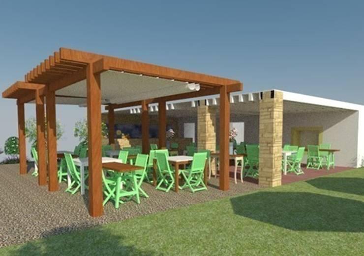 Vista zona de comedor exterior y barra 1: Locales gastronómicos de estilo  de Buena Pieza Interiorismo
