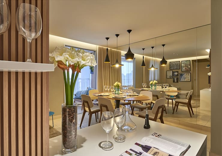 Sala de jantar com cozinha americana: Salas de jantar  por Fernanda Sperb Arquitetura e interiores