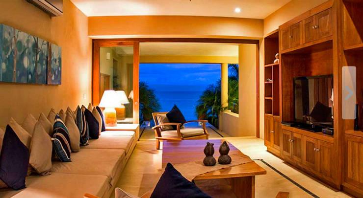 Salas de estar tropicais por BR  ARQUITECTOS