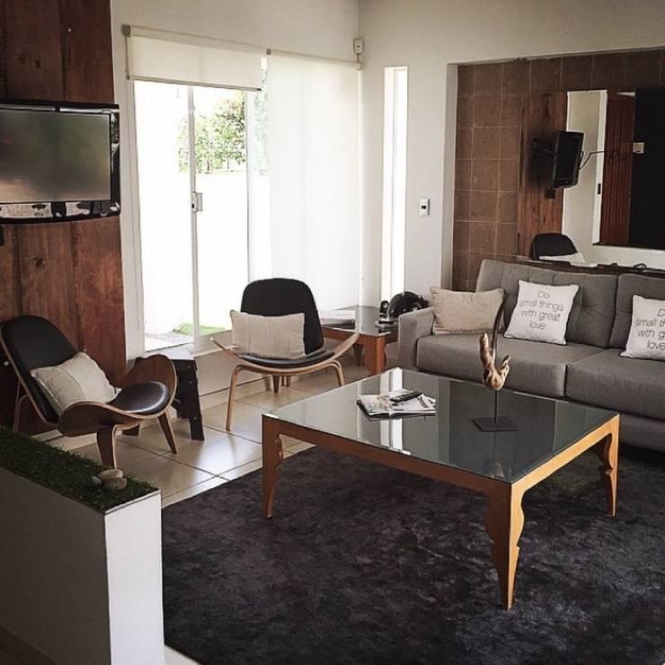 Livingroom: Salas de estilo  por DECO designers