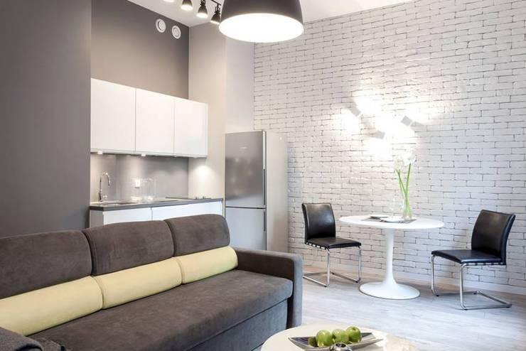 Salon z aneksem kuchennym i kącikiem jadalnianym: styl , w kategorii Salon zaprojektowany przez KODO projekty i realizacje wnętrz