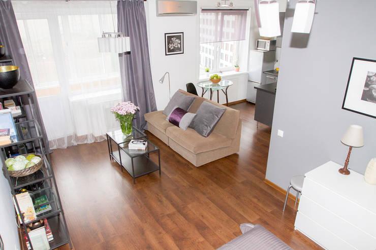 Декор квартиры - студии в Москве: Гостиная в . Автор – L'Essenziale Home Designs