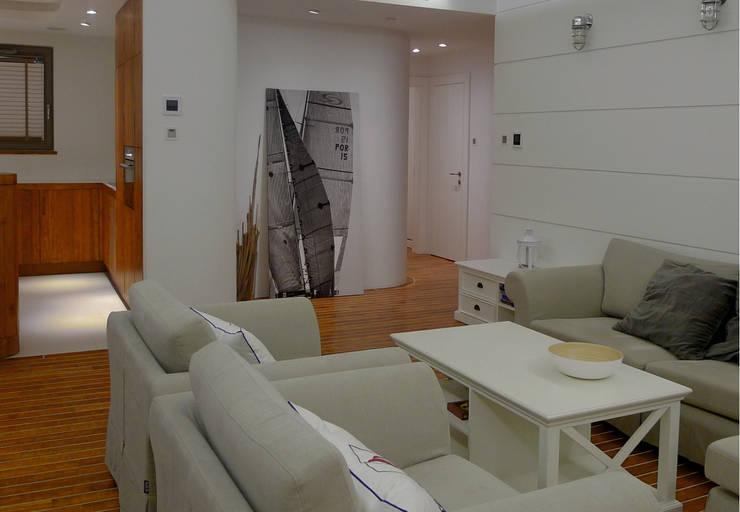 Apartament Waterlane Gdańsk: styl , w kategorii Salon zaprojektowany przez Ostańska design,
