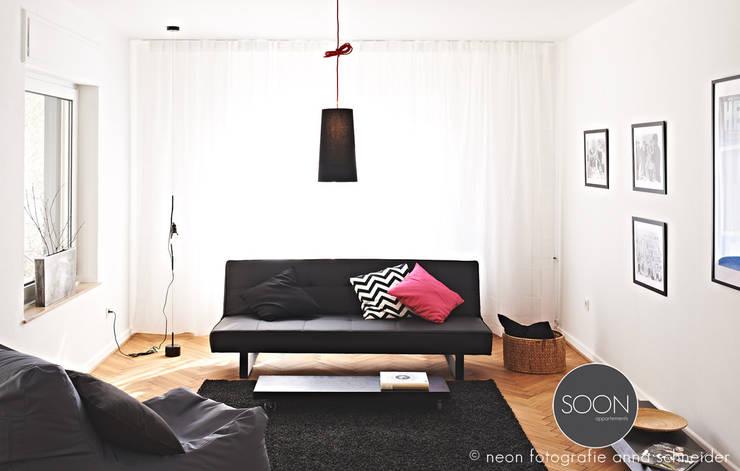 Ferienwohnung Wohnbereich:  Wohnzimmer von Architekturbüro Götz Oertel