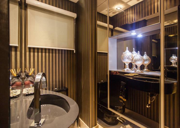 Lavabo sofisticado: Banheiro  por msaviarquitetura