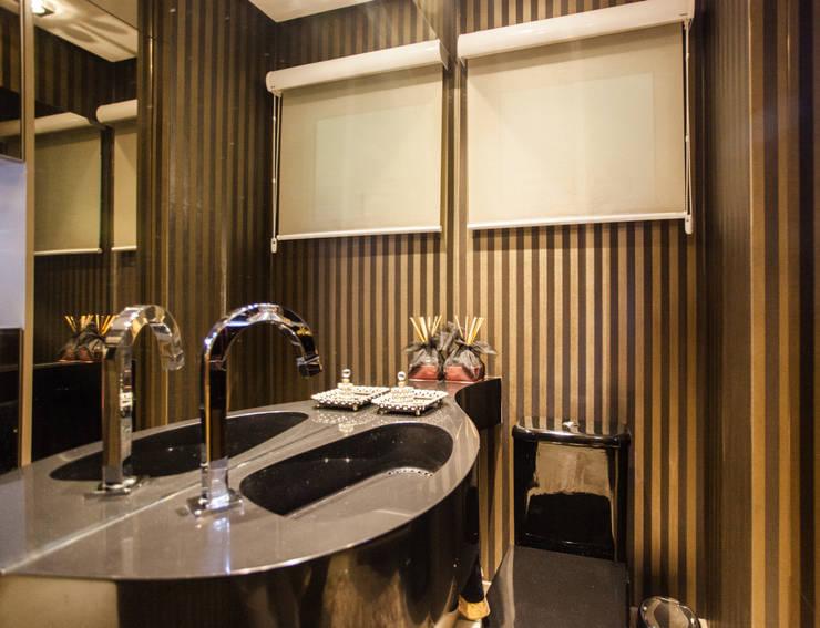 Lavabo sofisticado: Banheiro  por msaviarquitetura,