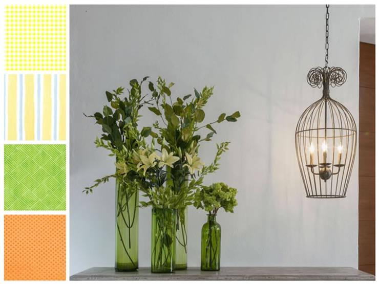 Follaje y lámpara en forma de jaula: Hogar de estilo  por MARIANGEL COGHLAN