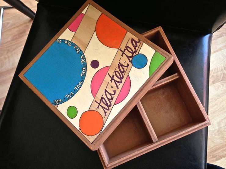 Caja de té circulos: Hogar de estilo  por Libel