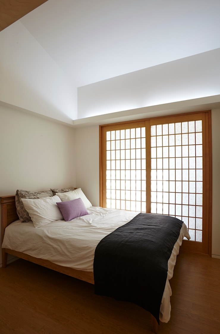 따뜻한 벽돌집: 스마트건축사사무소의  침실