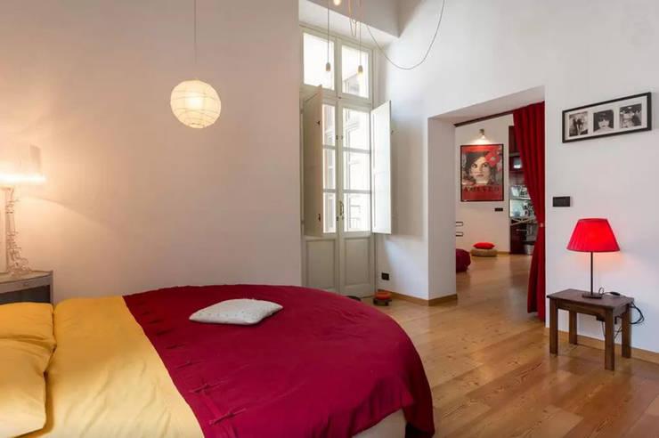 Camera da letto in stile in stile Industriale di  Simona Garufi