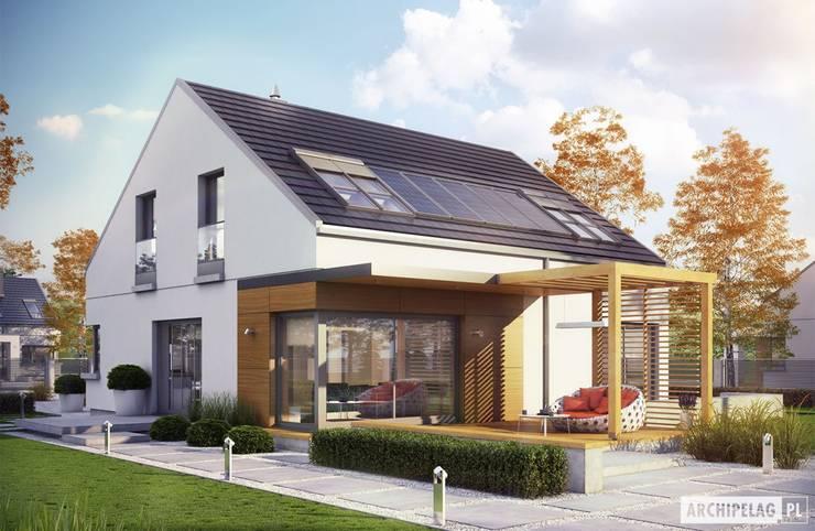 Projekt domu Edgar II G2 ENERGO PLUS: styl , w kategorii Domy zaprojektowany przez Pracownia Projektowa ARCHIPELAG,Nowoczesny