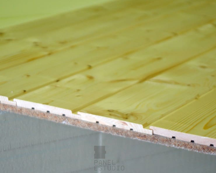 Panel bicapa para cubiertas aligeradas y forjados perdidos.:  de estilo  de panelestudio