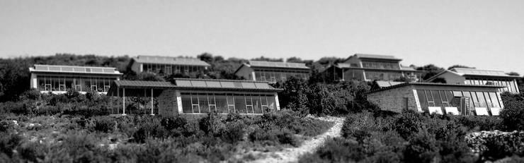 ECO HAMEAUX: Maisons de style de style Moderne par archestra
