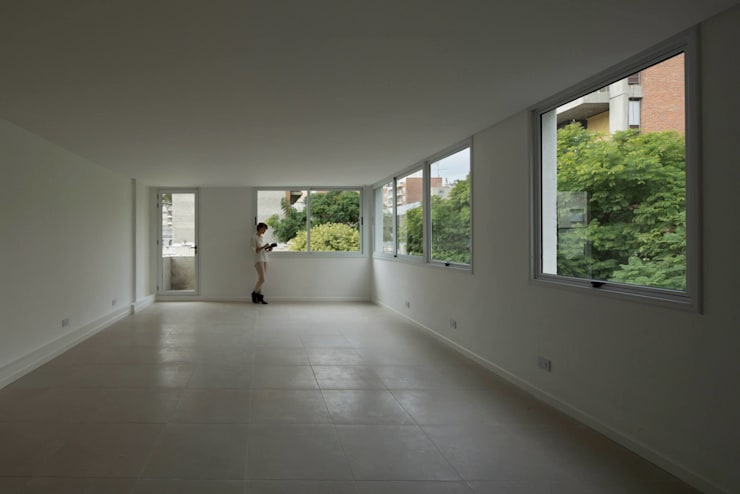 Edificio 9  de Julio: Estudios y oficinas de estilo  por CUMPA