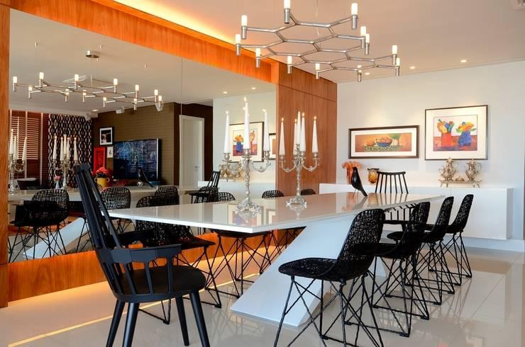 Ed. Luna Rosa: Salas de jantar  por Rodrigo Maia Arquitetura + Design