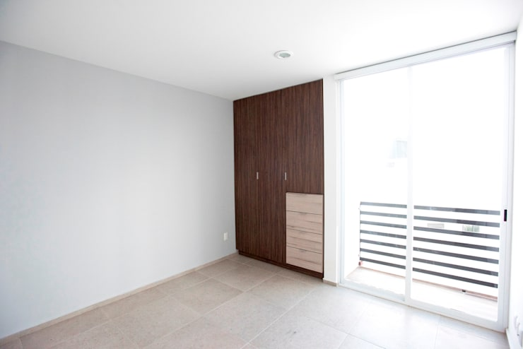 Closet: Recámaras de estilo  por JF ARQUITECTOS
