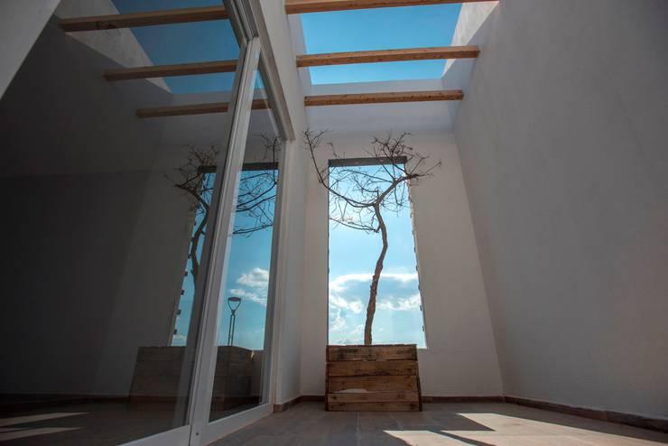 Terraza: Terrazas de estilo  por JF ARQUITECTOS