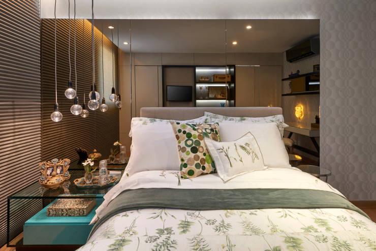 Apartamento LJ: Quartos  por Gláucia Britto